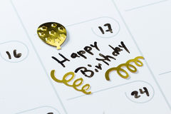 Happy birthday on a calendar Royalty Free Stock Photography