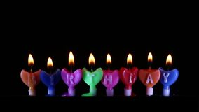 Happy Birthday candle Light on isolated black. Close up Happy Birthday candle Light on isolated black stock video footage