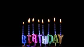 Happy Birthday candle Light on isolated black. Close up Happy Birthday candle Light on isolated black stock video
