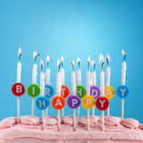 Happy birthday candles on blue background Stock Image
