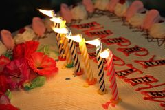 Happy birthday candles on a cake Stock Images