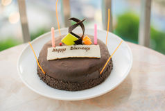 Happy birthday. Birthday candles and cake on table background royalty free stock images