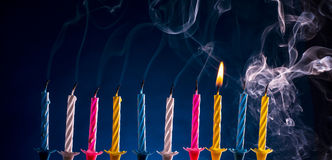 Happy birthday candles over blue Stock Photos