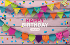 Happy Birthday card with colorful paper garlands and confetti. On pink wooden background stock illustration