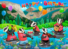 Happy Birthday card with funny badgers playing music Royalty Free Stock Photography