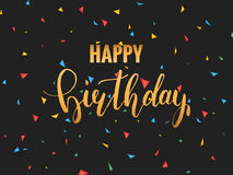 Happy Birthday card. Golden calligraphy. Festive birthday card template with lettering and confetti Royalty Free Stock Image
