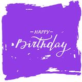 Happy birthday card. Handwritten text on abstract purple brush strokes. Royalty Free Stock Photography