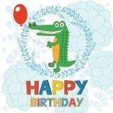 Happy birthday card with happy crocodile holding Royalty Free Stock Photo