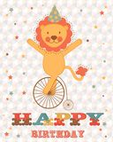Happy birthday card with happy lion. On wheel Royalty Free Stock Images