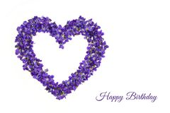 Happy birthday card. Heart shape flowers. Violets love symbol isolated on white background. Template for greeting card. Happy birthday card. Heart shape flowers royalty free stock photos