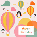 Happy birthday card with penguins. Happy birthday greeting card with flying penguins and hot air balloons Stock Images