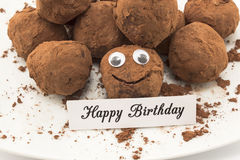 Happy Birthday Card with Smiley Chocolate Truffles.  royalty free stock photo