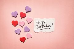 Happy birthday card with text and hearts on beautiful pink background. Anniversary concept stock photo