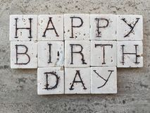 Happy Birthday on carved marble pieces Stock Image