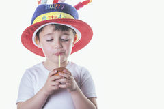 Happy Birthday. Child blowing out candles on his birthday Stock Photography