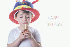 Happy Birthday. Child blowing out candles on his birthday Stock Images