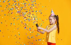 Happy birthday child girl with confetti on yellow background. Happy birthday child girl with confetti on colored yellow background royalty free stock image