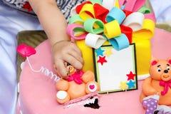 Happy birthday. Child pulls bear from Children's birthday cake royalty free stock photo