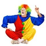 Happy birthday clown has an idea. Isolated stock photo