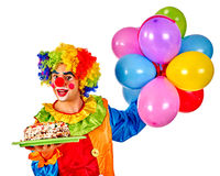 Happy birthday clown holding a bunch of balloons. Happy birthday clown holding cake and bunch of colorful balloons. Isolated stock photography