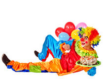 Happy birthday clown holding a bunch of balloons Royalty Free Stock Photos