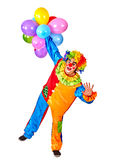 Happy birthday clown holding a bunch of balloons Royalty Free Stock Photography