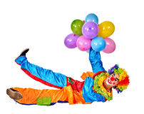 Happy birthday clown holding a bunch of balloons. Stock Photo