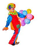 Happy birthday clown holding  bunch of balloons. Stock Photography