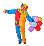 Happy birthday clown holding a bunch of balloons. Royalty Free Stock Photos