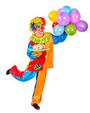 Happy birthday clown holding a bunch of balloons Royalty Free Stock Photo