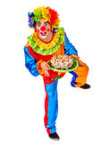 Happy birthday clown holding a bunch of balloons. Royalty Free Stock Image