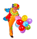 Happy birthday clown holding a bunch of balloons. Royalty Free Stock Photo