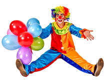 Happy birthday clown holding a bunch of balloons Stock Image