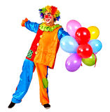 Happy birthday clown keeps bunch of balloons. Stock Photos