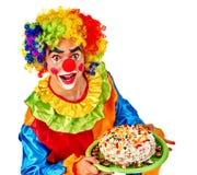 Happy birthday clown man keeps cake on plate. Stock Photography