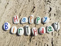 Happy birthday on colored stone letters Royalty Free Stock Photo
