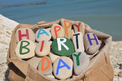 Happy Birthday composition of stone letters in a bag Stock Photos