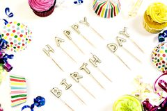 Happy birthday concept with copy space. Happy birthday concept bright colorful cupcakes with copy space on white background stock images
