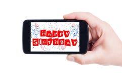 Happy birthday concept on smartphone display Stock Photo