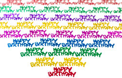 Happy birthday confetti. Colorful background of multicolored Happy birthday confetti pieces Stock Images