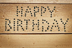 Happy Birthday congratulation made as text of bullet holes Royalty Free Stock Photos