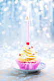 Happy Birthday cupcake. With a candle on a boketh background Royalty Free Stock Photo