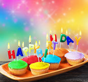 Happy birthday cupcakes with candles Royalty Free Stock Photography