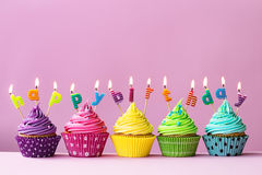 Happy birthday cupcakes. Cupcakes with candles spelling the words happy birthday Royalty Free Stock Photography