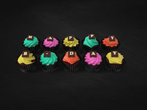 Happy Birthday cupcakes on chalkboard background. Happy Birthday cupcakes - illustration of colourful muffins witch cream and chocolate letters on blackboard Stock Photography