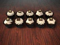 Happy Birthday cupcakes on dark wooden background stock photo
