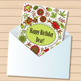 Happy birthday dear card in envelope on wooden background Royalty Free Stock Photo