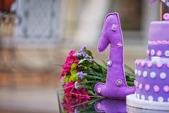 Happy birthday decoration. One year. Decorative textile figure o Royalty Free Stock Image