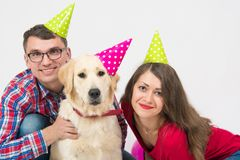 Happy birthday dog with friendly family over white royalty free stock image