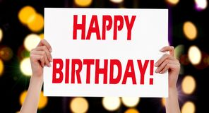 Happy Birthday! Female hands holding a placard Royalty Free Stock Photos
